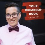 Your Breakout Book Podcast with Dana Kaye looking at the camera wearing a pink shirt and dark red bowtie