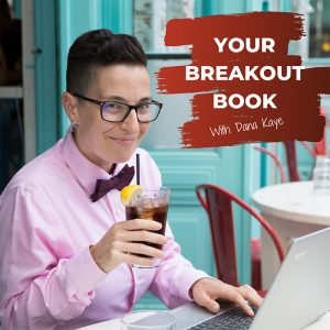Your Breakout Book Podcast with Dana Kaye looking at the camera while sipping on iced tea and sitting with her computer