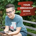 Your Breakout Book Podcast with Dana Kaye looking at the camera while sitting on a park bench wearing a teeshirt and shorts